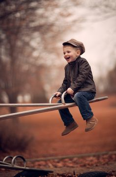 Cute little boy playing on playground equip