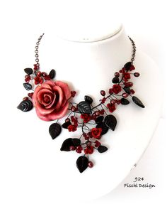 921 - Wedding jewelry Event necklace garland with Rose blossom, flowers and leaves in black and red colours    A precious georgious noble garland necklace for the victorian bride, the bridesmother, the bridesmaid and any else events and celebrations    This statement necklace is made of glass leaves, swarovski crystal beads, freshwater pearls, small metall blossoms, a georgious rose blossom of cold porcelan handmade in France, black colored wire and a rhodium-platted copper necklace…