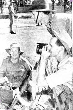 On the right: Lieutenant D. Kuskie (Maryborough) watches Private J. Buchanan setting a signal lamp. Seated on the left of the picture is Private F. Ledger of Cooroy. Matron Of Honour, Military Personnel, Holy Spirit, Brisbane, Bridesmaid, Watches, Pictures, Holy Ghost, Maid Of Honour