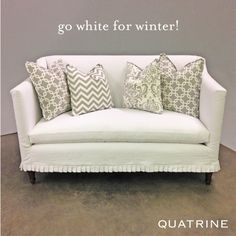 Whites aren't just for summer! Featuring our Antoinette love seat with mismatched grey and white decorative pillows!