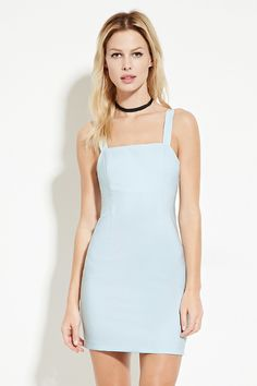 A sleeveless woven mini dress with a hook-eye back closure, a concealed back zipper, and a back cutout accent.
