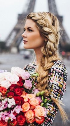 """An """"Elsa"""" Braid: Chunky side braids are dreamy wherever you are. (But a Parisian backdrop never hurts.)"""