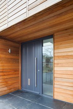 Grey doors are here to stay. Learn more about Urban Front grey doors and enquire now. House Cladding, Timber Cladding, Cladding Ideas, Grey Garage Doors, Grey Front Doors, Contemporary Front Doors, Timber House, Front Entrances, House Front