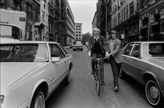 Andy Warhol on his Bicycle, E. 11th St., NYC. (1981) Walked by Christopher Makos. Photographer: Robert Levin/Corbis