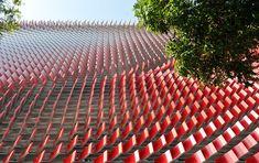 a 3D facade of 7,553 tiles wraps KIA's brand with algorithmicpatterns