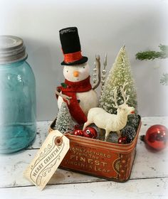 Tin With Christmas Scene. Snowman, Reindeer and Christmas Tree.