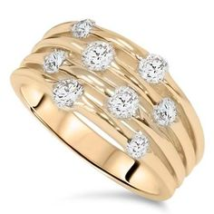 i like how wide this ring is and how randomly the diamonds are interspersed