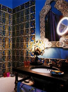 Bathroom. Wooden sink. Brass. Tiles. Prussian blue. White. Gold. Orange. Lamp.