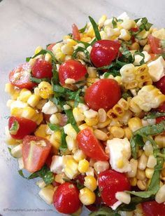 This Grilled Corn Basil & Tomato Salad brings fresh and summer straight to your next picnic, barbecue or luncheon.
