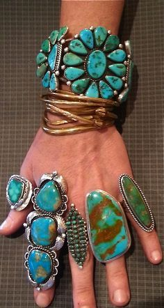 Turquoise and sterling silver bracelet and rings.I want them all.
