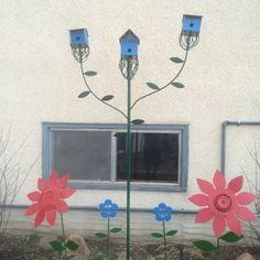 Metal birdhouse tree plus flowers