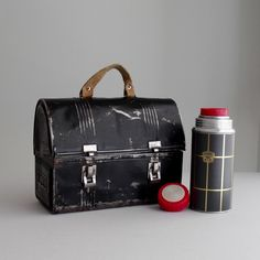 antique metal lunch box and thermos
