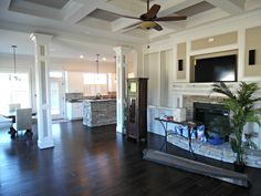 Great room. Fireplace, coffered ceiling