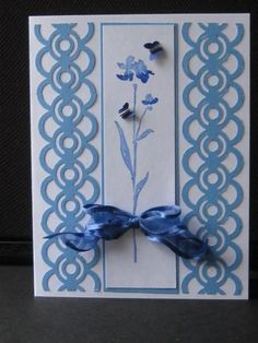 handmade card ... Rumpled Blue ... blue and white ... watercolor effect with simple floral stamp ... colums created with border punches ... beautiful!!