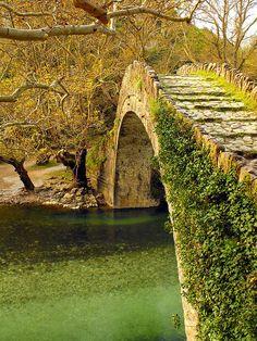 Old stone bridge above Voidomatis River in Epirus, Greece