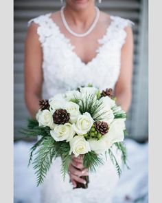 Love the white roses (replace with lilies), pine cones and greenery