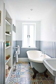 en suite with moroccan floor tiles and blue panelling
