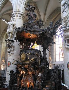 this fabulous wooden carving created by Hendrik Frans Verbruggen in 1699, depicting Adam and Eve expelled from Eden, forms the pulpit in St. Michael and St. Gudula Cathedral in Brussels: