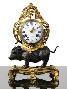 A gilt-bronze and patinated bronze clock, Louis XV, the dial and the movement signed CHles BALTHAZAR / A PARIS