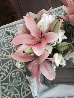 Pink lily and white wedding bouquet by Reynolds Treasures
