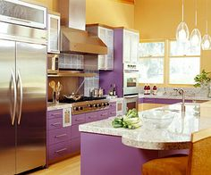 Purple Passion..An energetic purple colors the cabinetry in this contemporary-style kitchen, picking up flecks of amethyst in the granite countertops. The homeowners have a passion for colorful modern art and wanted their kitchen to reflect that interest.