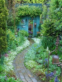 Pathway to a lovely blue garden shed