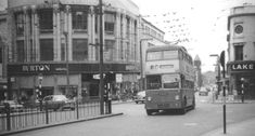A trolley bus on route 13, Wolverhampton to Merry Hill, approaching Queen Square. It is a Guy BT bus with a Park Royal body, built in 1949.