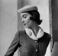 August 1959 - Model wearing tweed suit with plush hat