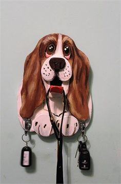 Perfect gift for any dog lover. These leash holders have a tongue to hang the main leash and two more hooks to hang keys or leashes on.   You can have them designed to look like your pet or go by the standard breed.   These are not made until ordered. We are currently taking 2-3 weeks to create.    Approximately 11 inches tall