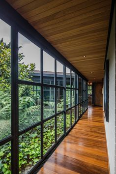 A central open-air garden filled with plants connects the wings of this modern house, with sliding glass walls opening the garden to the interior. architecture This Triangular Shaped House Makes Room For An Interior Garden Garden Architecture, Modern Architecture House, Modern House Design, Amazing Architecture, Interior Architecture, Concept Architecture, Architecture Facts, Modern Glass House, Glass House Design