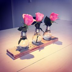 Created a nice vase from 3 old lightbulbs and some old wood...  #recycling #driftwood #lightbulbs #vase #flowers #diy