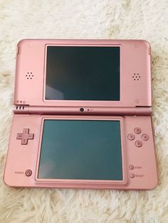 Nintendo Dsi XL in great condition. Plays games flawlessly, comes with a stylus and two BrainAge games. Nintendo Dsi, Nintendo Ds Lite, Super Nintendo, Nintendo Games, Nintendo Consoles, Nintendo Switch, Nintendo Tattoo, Ds Xl, Pink Games