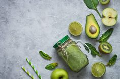 healthy green food background smoothie and ingredients