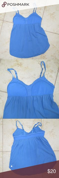 Lululemon Blue Top Perfect top for Yoga or working out. Features a built in bra and adjustable straps. Good condition.   SIZE NOTE: does not have tags on the inside, so I am not 100% sure what size it is. I usually wear a 6/8 or Medium so that is my guess. lululemon athletica Tops Tank Tops