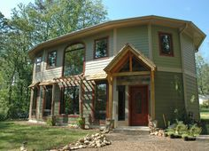 This passive solar home with timber frame entry is a stunning example of our Crescent Chalet model. Our homeowners, the Cleres, kept a very informative blog about their experience, from breaking ground to final trim. #PassiveSolar #CrescentChalet #roundhouse