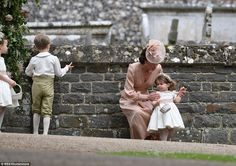 Despite the fact that she was wearing a dress worth hundreds of pounds the Duchess seemed ...