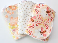 This is the most adorable burp cloth set. Can be made in a burp cloth or bandana bib just select your final choice from the drop down menu. The polka dots are done in a gorgeous metallic gold. The backs are done in the softest white mink dot! These make an adorable baby shower gift. Perfect for fall spring or summer! You can order a sample of the minky dot for $1.00 (to cover shipping) just click here to purchase:For current production and ship times visit our FAQ page.
