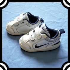 online retailer 54668 49de5 Description  Nike shoes Size 5 White with dark blue Velcro Some minor wear  Otherwise in good condition.
