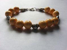 Orange and Silver Hidden Frog Bracelet by tahdeah on Etsy, $5.00
