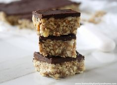 This power bar recipe has hazelnuts, sunflower seeds, almonds and chocolate topping plus they are gluten free, vegan, dairy free, grain free and paleo.