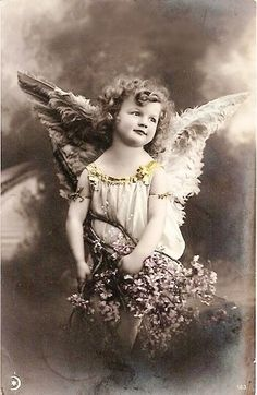 Vntg child w/wings holding floral branches.  Perfect for framing ~ The Feathered Nest ~: A tattered angel in progress!