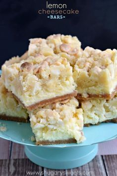 Lemon Cheesecake Bars: delicious layers of cookie crust, lemon cheesecake and a lemon cookie dough on top! Seriously amazing!!
