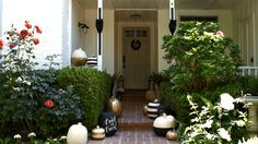 See how this stylish family decorated their outdoor space for Halloween./