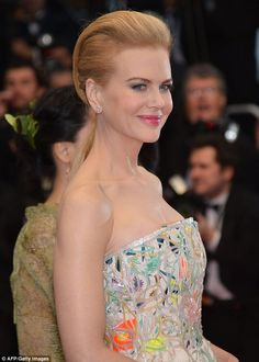 I love it! This dress is a dream - the fabric is stunning!She loves it: Nicole Kidman doesn't mind a little rain as she arrives at the opening of the 66th Cannes Film Festival