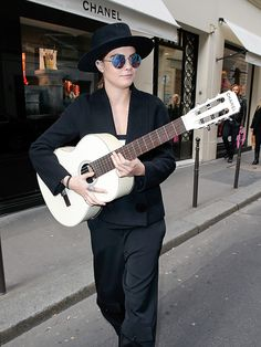 Star Tracks: Tuesday, March 10, 2015 | PLAYING AROUND | After attending the Stella McCartney show on Monday at Paris Fashion Week, Cara Delevingne takes to the streets with a guitar (Chanel, of course) and characteristically eclectic sunglasses.