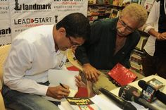Satyen signing a copy for Naseeruddin Shah — at Landmark