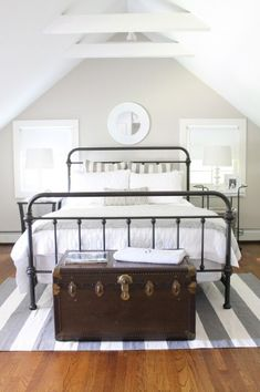 Eclectic Home Tour The Picket Fence Projects - love the iron bed in this guest bedroom eclecticallyvintage.com