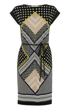 We love this new season tribal prined tshirt dress with its scarf placement detail across the fabric. The piece features a slashed neckline and pintucked cap sleeves. The dress is finished with a material tie rope belt to give definition at the waist.