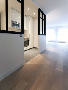 Renovation of a Parisian apartment. Open modern white Ikea kitchen … by Laminate Flooring On Walls, Foyer Flooring, Hardwood Floors In Kitchen, Wood Flooring, White Ikea Kitchen, Kitchen Modern, Floor Design, House Design, Parisian Apartment