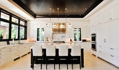 Tuthill Architecture: Incredible U shaped kitchen with mahogany stained walnut beadboard tray ceiling and ...